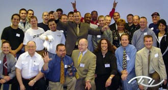 "Peter Merry with the attendees of his seminar titled ""Better Consultations Bring Better Bookings"" presented in Bloomington, IL on May 13th of 2003. Click on this photo to see an excerpt of this seminar on YouTube."