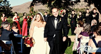 Andrew & Megan smiling as they walk back down the aisle after they just got married at Arroyo Trabuco Golf Club in Mission Viejo, CA. (Photo Credit: Jeffrey Neal Photography)