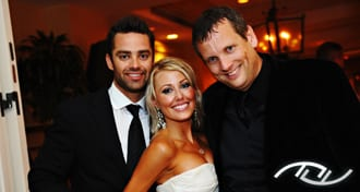Ryan & Celena with Peter Merry at their Wedding Reception at the Surf & Sand Hotel in Laguna Beach, CA. (Photo Credit: Jim Kennedy Photographers)