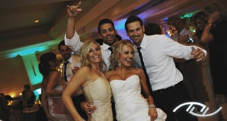 Ryan & Celena dancing and celebrating at their Wedding Reception with their friends at the Surf & Sand Hotel in Laguna Beach. (Photo Credit: Jim Kennedy Photographers)