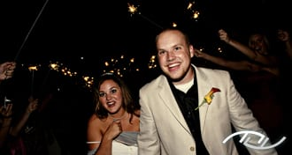Andrew & Megan leaving their Wedding Reception as their guests give them a sparkler send-off at Arroyo Trabuco Golf Club in Mission Viejo, CA. (Photo Credit: Jeffrey Neal Photography)